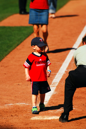 bases: Young fan participates in post game running of the bases, Minneapolis, MN Editorial