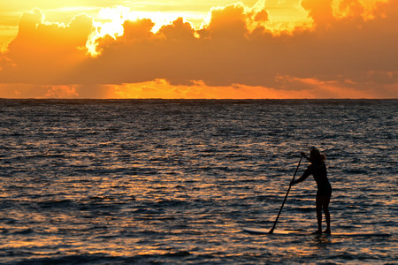 boarder: A Lone Paddle Boarder at Sunrise on Oahu East Coast