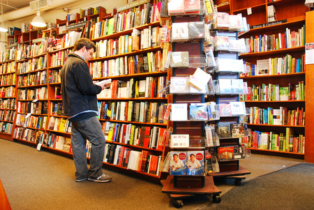 bookstore: An adult man shops at a bookstore