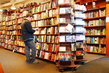 An adult man shops at a bookstore