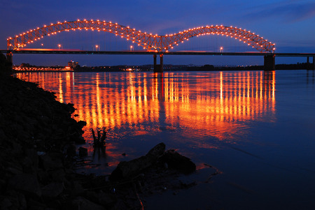 Lights of the De Soto Bridge in Memphis Reflect in the Mississippi River