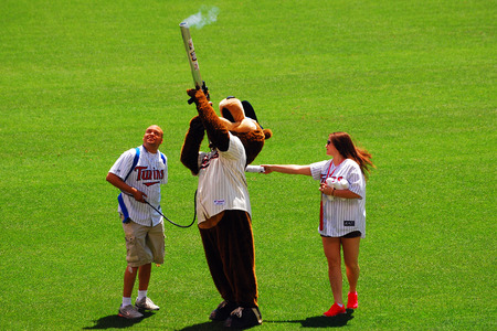 partake: Minnesota Twins Mascot and his Helpers partake in the T Shirt Toss at Target Field Editorial