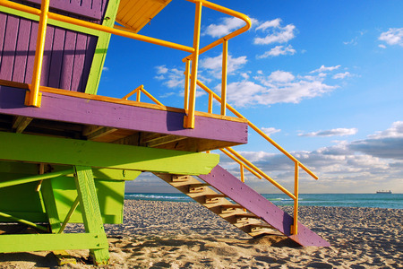 life guard stand: Purlple and Green Lifeguard Shelter on South Beach, Miami Stock Photo