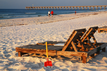 pensacola beach: A seat awaits relaxation seekers in Pensacola Florida on the shores of the Gulf of Mexico