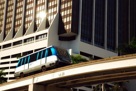 The Metomover Traveling Through Downtown Miami Editorial