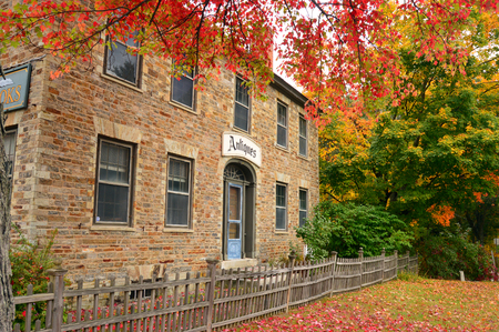 Autumn View of a Stone House Converted to an Antique Store in New Hampshire Stock Photo