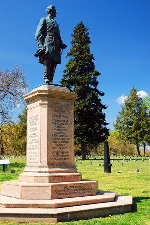 tree service pictures: A statue honoring General Humphreys Pennsylvania Division sits in a Civil War Military Cemetery in Fredricksburg Virginia Stock Photo