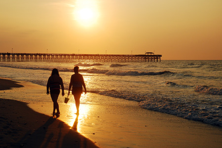 grand strand: A sunrise stroll along the shore in Myrtle Beach, South Carolina Stock Photo