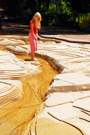 A Young Girl Wades Through a Scale Model of the Mississippi River on Mud Island, Memphis, Tennessee Editorial