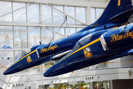 f 18: F A 18 Hornets Blue Angels are suspended over the Naval Air Museum in Pensacola