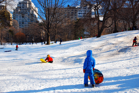 Sledding in Central Park on a snow day Editorial