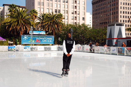 A Staff member Tests the Ice at a Skating Rink in Pershing Square, Los Angeles