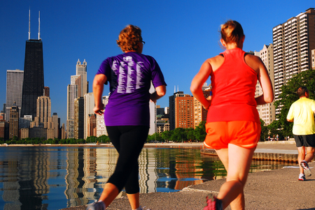 Joggers take a running trail along the Shores of Lake Michigan in Chicago