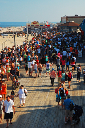 Pt Pleasant, NJ, USA July 25, 2009 Beachgoers crowd the boardwalk in Point Pleasant, on the Jersey Shore, on a sunny summer day Editorial