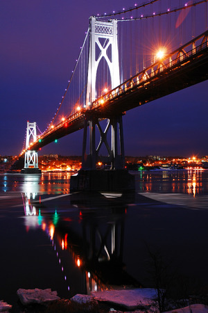 Mid Hudson Bridge reflections in an Icy Hudson River Stock Photo