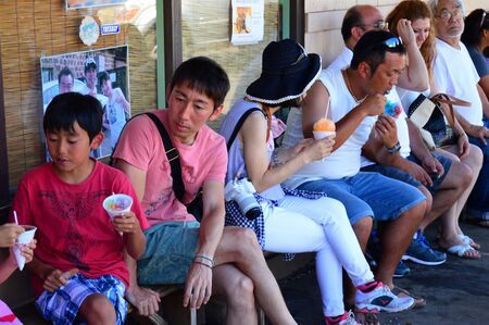 Tourists gather at the Matsumoto General Store for classic Hawaiian Shave Ice Editorial