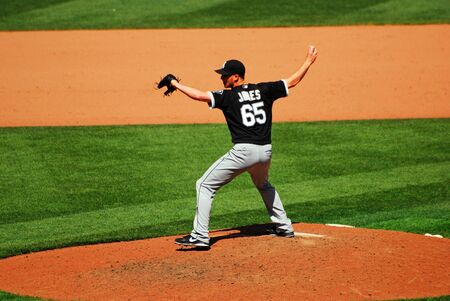 Nate Jones of the Chicago White Sox demonstrates an unusual pitching formation Editorial