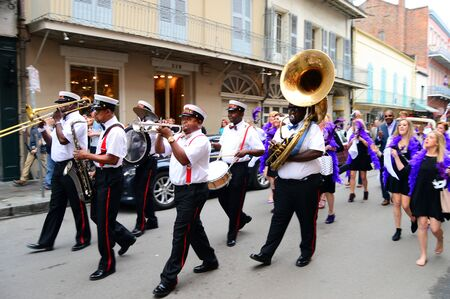 A Second Line leads a procession through the French Quarter of New Orleans