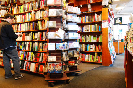 A young man Browses for books at the Harvard Book Store in Cambridge