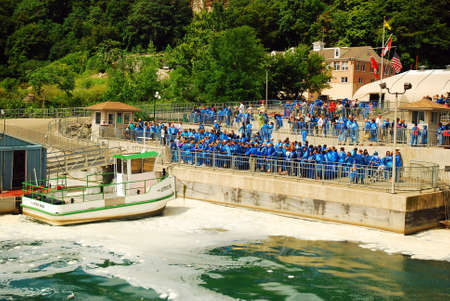 A Crowd Gathers for the Maid of the Mist boat ride in Niagara Falls, Canada Editorial
