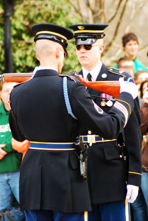 An honor guard has his rifle inspected before guarding the tomb of the Unknown Soldier in Arlington National Cemetery