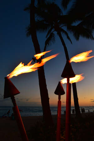 Traditional torches burn at dusk on Waikiki Bech