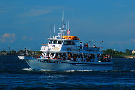 A charter fishing boat departs from the harbor