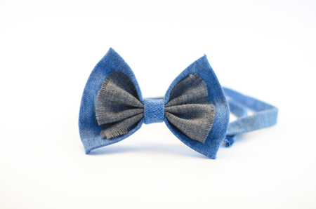 butterfly bow: Bow tie with his hands on a white background