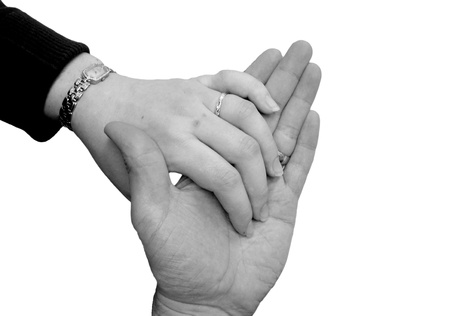 fondness: Monochrome of Husband and wife holding hands showing wedding rings