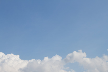 puffy: White puffy clouds on the background blue sky Stock Photo