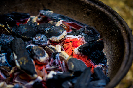 chargrill: glowing coal,charcoal for grill smoldering, burning in the fireplace
