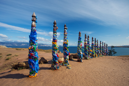 shamanism: Poles hitching post near Khuzhir at Olkhon island in Siberia Stock Photo