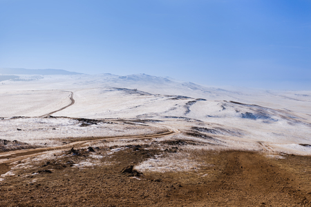 Road with snow in winter season at Olkhon Island