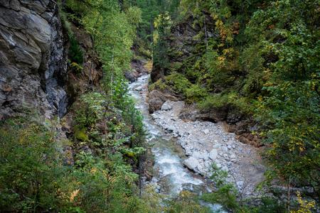 Mountain stream among the mossy stones, Taiga
