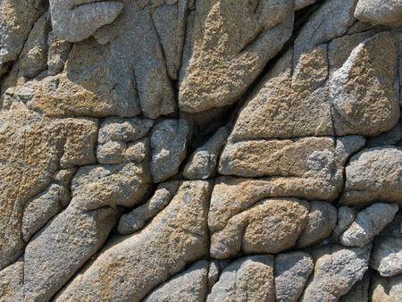 seacoast: A close-up of the texture of very rough surface of rock on seacoast. Russian Far East, Japanese sea, Primorye. Stock Photo