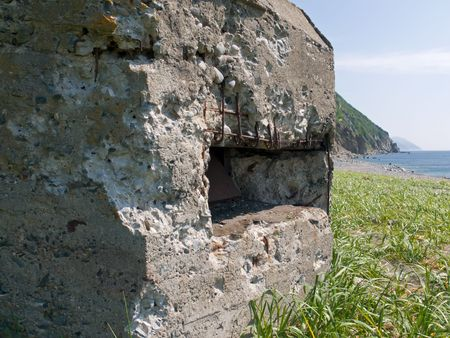 fortifying: A close-up of an very old deatroyed pillbox on seacoast. Japanese Sea, Russian Far East, Primorye.