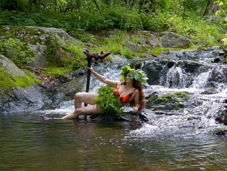 woodsy: A woman lies at very small waterfall on small woodsy river. Russian Far East, Primorye, state nature reserve Lazovsky, Suchoy spring. Stock Photo