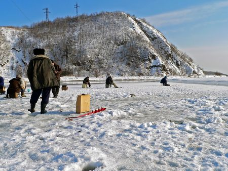 handline fishing: Winter fishing on sea. People is fishing the smelt. Russian Far East, Primorye, Japanese sea, Sokolovskaya bay. Series.