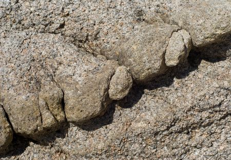 A close-up of a surface of very rough and granulated stone at seacoast. Stock Photo - 3592032