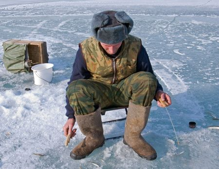 handline fishing: A winter fishing on river. People is fishing the smelt. Russian Far East, Primorye, Kievka river.