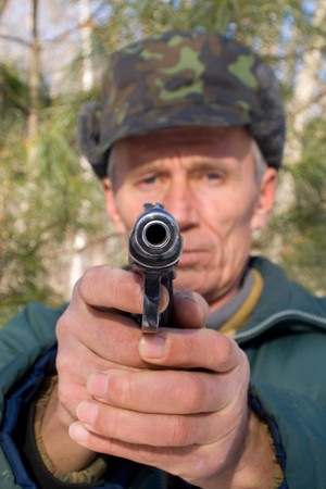 stickup: The man, aiming from a pistol. Stock Photo