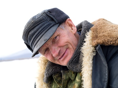 furred: A portrait of the old man on winter fishing.