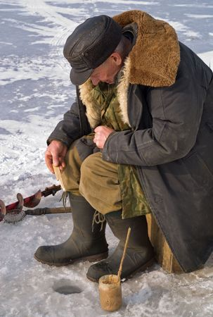 handline fishing: Winter fishing on river. People is fishing the smelt.