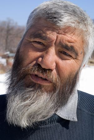 A portrait close-up of the old men with grey beard. Small indigenous people of Russian Far East. photo