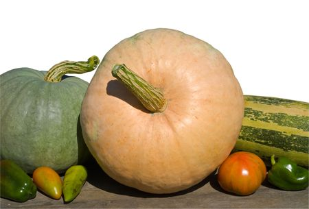 A close-up of the vegetables: pumpkins; peppers; tomato; vegetable marrow. Isolated on white. photo