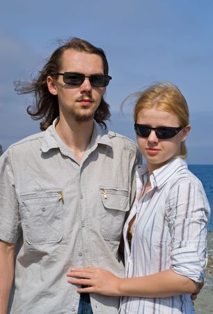 dearness: Portrait of the young man and woman in sunglasses. Summer, sunny day.
