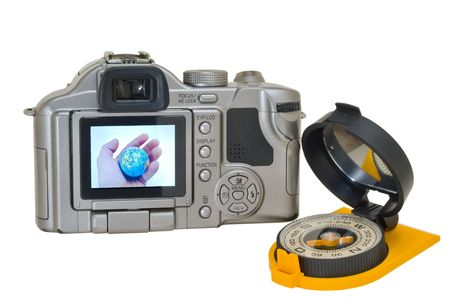 A close up of the digital camera with globe in hand on display and compass. Isolated on white. photo