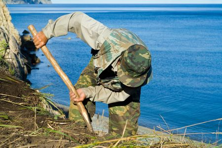 The archeologist digs ground at sea. He explores new places for Institute of Archeology and Ethnography (Vladivostok). Stock Photo - 6746686