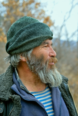 man with a goatee: A portrait of the old mongoloid man with grey beard.