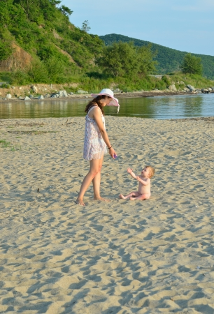 The young mother with baby on beach. photo